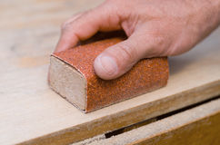 Sanding with a sanding block Royalty Free Stock Photography