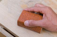Sanding with a sanding block Stock Image