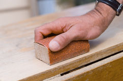 Sanding with a sanding block Royalty Free Stock Image