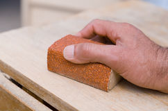 Sanding with a sanding block Royalty Free Stock Images