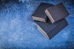 Sanding sponges on metallic background abrasive tools Royalty Free Stock Images