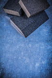 Sanding sponges on scratched metallic background abrasive materi Royalty Free Stock Images