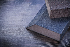 Sanding sponges on vintage wooden board abrasive tools Stock Photos