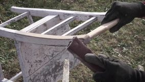 Sanding, women using sandpaper on an old chair stock video