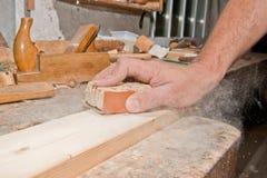 Sanding wood. Men sanding wood with sandpaper Royalty Free Stock Images