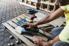Sanding wood after sawing Royalty Free Stock Image