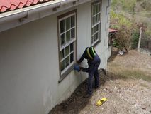 Sanding a wooden ledge in the tropics. A worker using to tool to prepare a windowsill for varnish stock video footage