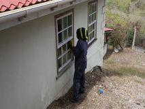 Sanding a wooden ledge in the tropics. A worker using to tool to prepare a windowsill for varnish stock footage