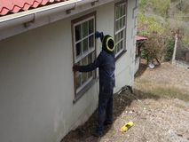 Sanding a wooden ledge in the tropics. A worker using to tool to prepare a windowsill for varnish stock video