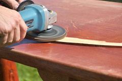 The Sanding wooden table carpenter working Stock Images