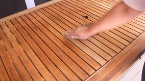 Sanding Wooden Table 3. Person sanding a wooden table by hand to prepare it for varnishing stock video footage