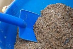 Sandkasten-Schaufel Stockbild