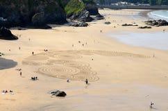 Sandkonst på den Tolcarne stranden, Newquay Fotografering för Bildbyråer