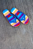 Sandle on street. Colorful of a sandel on gray Royalty Free Stock Images