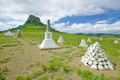 Sandlwana hill or Sphinx with soldiers graves in foreground, the scene of the Anglo Zulu battle site of January 22, 1879. The grea Royalty Free Stock Photos