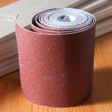 A sandpaper roll. On a work table Royalty Free Stock Photos
