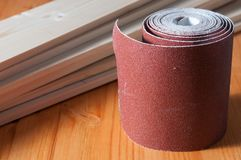 A sandpaper roll. On a wooden work table Stock Photography