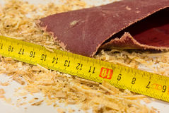 Sandpaper, ruler and sawdust. Sawdust, a ruler and abrasive (sandpaper) on desktop Stock Photo