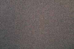 Sandpaper texture. The emery paper. The sandpaper texture. Emery paper. Background Stock Images