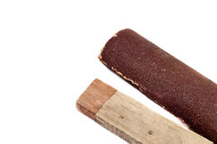 Sandpaper and wood on white background. Isolated Royalty Free Stock Images