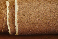 Sandpaper on wooden background Stock Photography