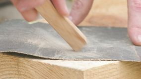 Sandpapering of wooden plank using glass-paper stock footage
