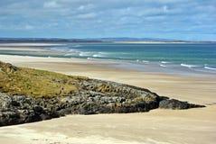 Sandpappra havet och vagga Arkivbilder