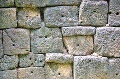 Sandpappra stenen i delen av väggen, historisk muangsing för prasat parkerar i Kanchanaburi, Thailand arkivfoto