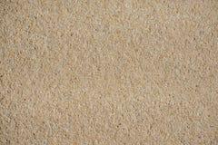 Sandpappra textur, bruntsand, bakgrund från sand royaltyfria foton