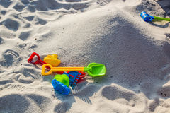 Sandpile and toys Royalty Free Stock Images