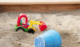 Sandpit com brinquedos Imagens de Stock