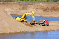 Sandpit - excavator and tipper Royalty Free Stock Image