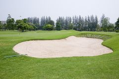 A sandpit at a golf course Stock Images