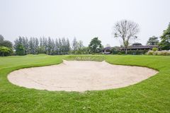 A sandpit at a golf course Royalty Free Stock Image