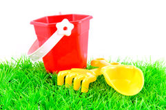 Sandpit toys on green grass Royalty Free Stock Photo