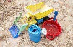 Sandpit toys. Sanpit toys in white sand Stock Photos