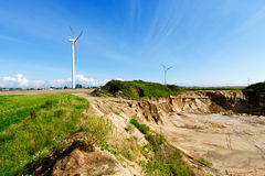 Sandpit and wind turbines Stock Photo