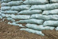 Sandsäckar för flodskydd Royaltyfri Bild