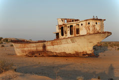 Sands of the Aral Sea. Rusty ship lying in the sand at the former Soviet Aral Sea port of Moynaq in Uzbekistan Stock Photography