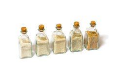 Sands collection in glass bottles. Beach sands varieties collection in five small glass bottles Royalty Free Stock Image