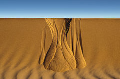 Sands of time. Naturally formed hour glass pattern in the sand dune Stock Photos