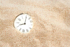 Sands of time. Pocket watch in the sand with the concept of sand of time, good for a background royalty free stock photography