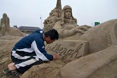 Sandsculpture artist working on his sculpture. Fukiage, Kagoshima, Japan, April 30, 2007, Sand sculpture artist working on his sculpture of Charles Lindbergh in royalty free stock photo