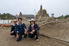 Sandsculpture artists in front of their sculpture. Kagoshima, Japan, April 30, 2007, A sand sculpture artists in front of their sculpture of Charles Lindbergh in royalty free stock image