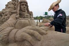 Sandsculpture artists working on his sculpture. Fukiage, Kagoshima, Japan, April 30, 2007, Sand sculpture artist working on his sculpture of Charles Lindbergh in stock images