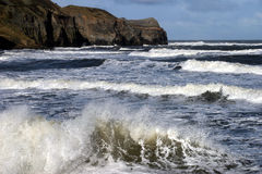 Sandsend. Looking north with breaking waves royalty free stock photos