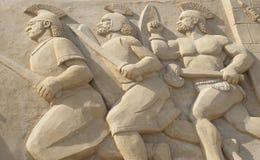 Sandskulptur av roman krigare i strid Arkivbilder