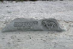 Sandskulptur - barfota strand arkivfoto