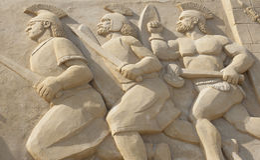 Sandskulptur von römischen Kriegern im Kampf Stockbilder