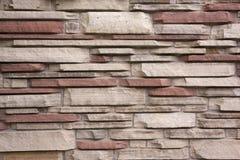 Sandsteinwandhintergrund stockfoto
